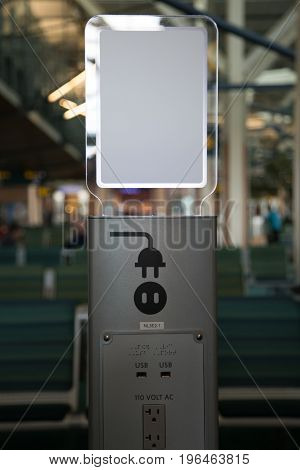 Electrical socket for digital devices airport background concept charging station