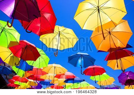 Multicolor umbrellas. Street art. Puerto Banus city, Marbella, Andalusia, Spain.
