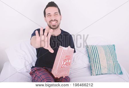 Man Eating Popcorn And Watching Movies.