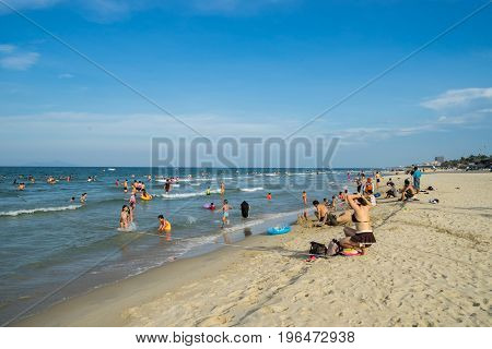Danang Vietnam - June 19 2017: Unidentified people relaxing in My Khe beach in Danang summertime