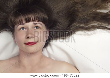 beautiful model girl with long hair top view on white