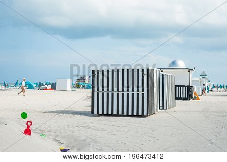 Miami, Florida, USA - July 28, 2012; Striking black and white vertically striped black shed on beach Miami Florida