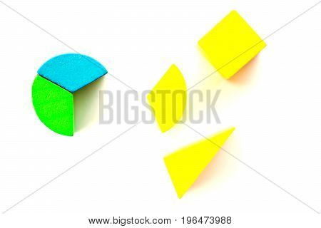 Colorful wooden round toy block wait to fulfill with different shape on white background