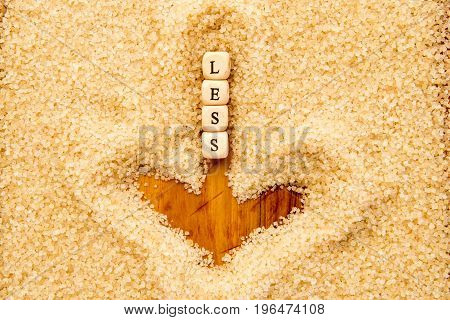 Less Sugar - Wooden Block Letters In Downward Arrow Drawn In Sugar
