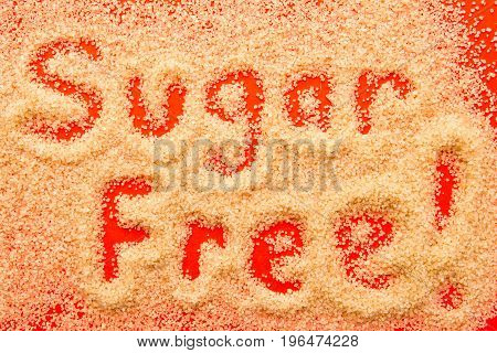Sugar Free - Hand Written In Raw Sugar Granules On Red Background