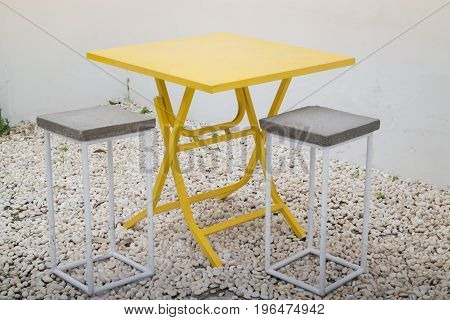 Applied chairs from metal and concrete stock photo