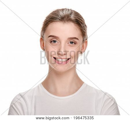 Portrait of beautiful young fresh woman with beaming smile