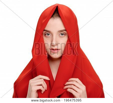 Young attractive woman wrapped in red scarf