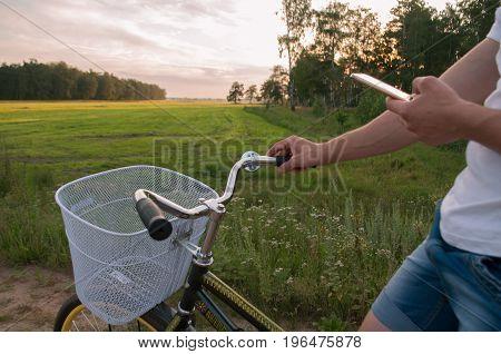 Cyclist Using Navigator On Your Smartphone,