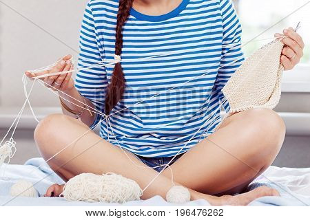 Woman Knits A Sweater