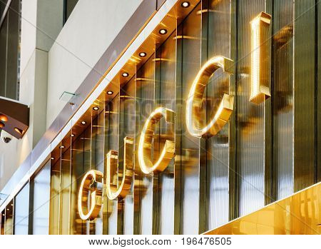 Singapore - February 17 2017: Logo of Gucci store at the Shoppes at Marina Bay Sands. The luxury fashionable store in the mall of Singapore is a popular tourist attraction of Asia.