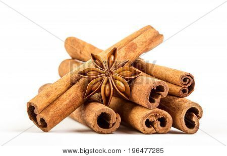 Close up brown cinnamon stick with star anise spice isolated on white background