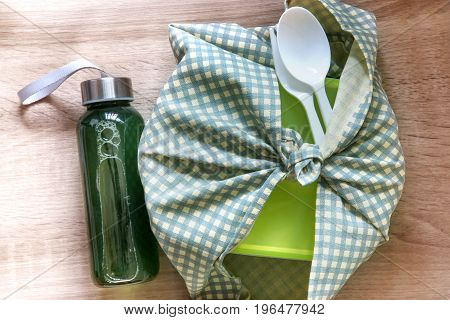 Healthy lunch box wrapped by Japanese wrapping cloth Furoshiki style with green vegetables and fruits juice bottle Homemade Healthy lunch box set for diet and healthcare concept