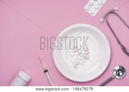 Pills Served As A Healthy Meal. Drug Capsule On White Plate On Pink Background