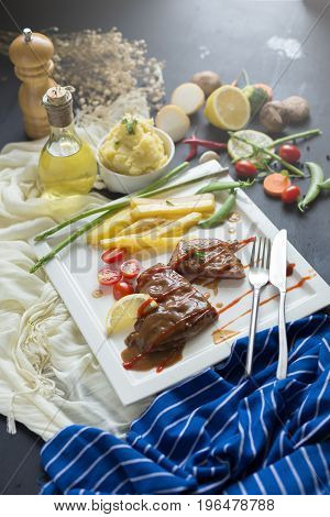 Fresh Grilled Meat. Grilled Beef Steak On White Plate French Fries And Mashed Potato With Spoon, In
