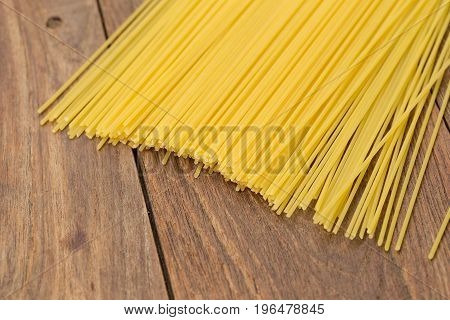 Yellow Long Spaghetti On A Rustic Background. Yellow Italian Pasta. Long Spaghetti