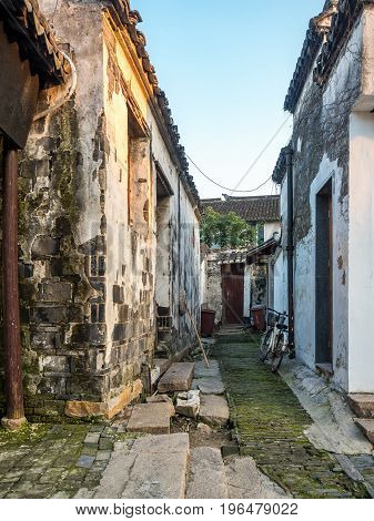 Suzhou, China - Nov 5, 2016: Laneway to ancient residential houses at the historic Zhouzhuang Water Town. The township is more than 900 years old.