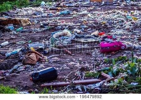 A huge pile of debris in the nature. Pollution of nature. Illegal dump construction waste in the background of nature.