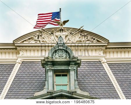 Roof Decorations Flag Old Executive Office Dwight Eisenhower Building Vice President's Office Washington DC. Located next to White House built from 1871 to 1888