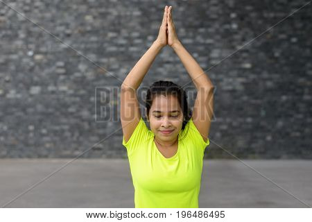 Young Woman Relaxing While Practising Yoga