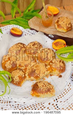 Sweet brioche buns stuffed with apricot and peach jam with streusel