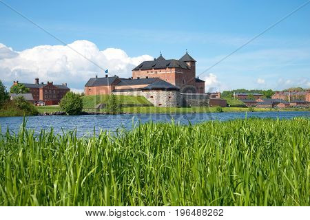 Sunny June day on the Vanajavesi lake. View of the old fortress of Hameenlinna, Finland