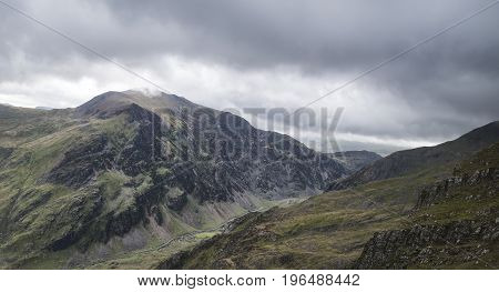 Landscape View Of Glyder Fawr Peak In Snowdonia From Halfway Up Mount Snowdon In Low Cloud