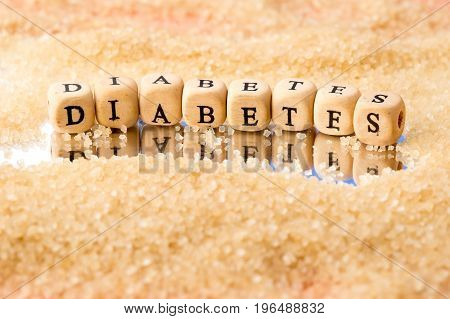 Diabetes - In Wooden Block Letters With Granules Of Sugar On Mirror Background