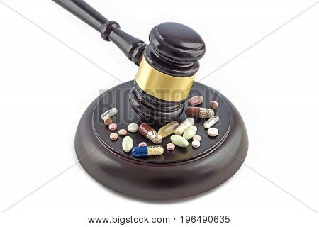 judge gavel and various drugs tablets and pills isolated on a white background justice and medicine concept