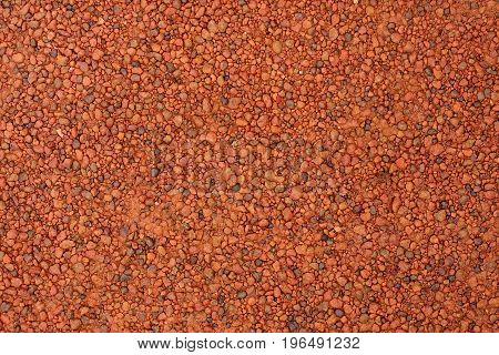 Red laterite gravel for use as background.