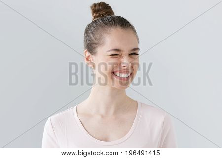 Portrait Of Young Attractive Woman Isolated On Gray Background, Showing White Teeth In Wide Friendly