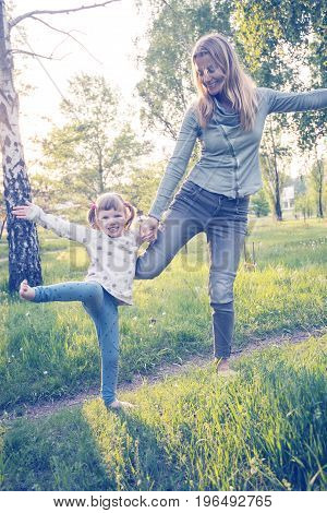 Happy Mother And Her Little Daughter Having Fun