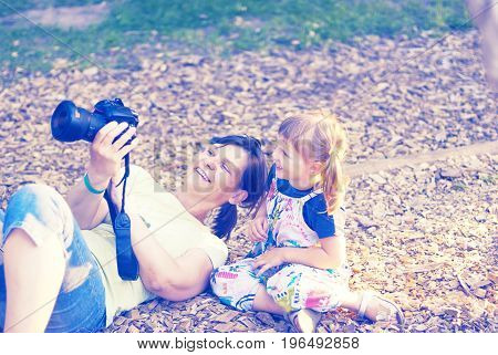 Joyful Little Girl With Her Happy Mother Are Make Photo