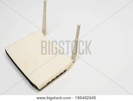 White wireless router with two antenna for home computer network