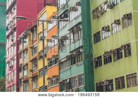 Old Houses Surrounded Modern Skyscrapers In Hong Kong. Hong Kong Is Popular Tourist Destination Of A