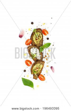 Three Sandwiches With Guacamole Sauce, Pesto And Cream Cream Served On A Clean White Background..