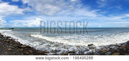 Panoramic view of the rugged coastline with rocks and surf in southern Taiwan