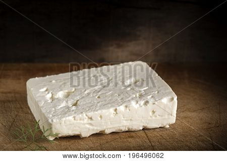 Telemea - Romanian cheese on wooden background