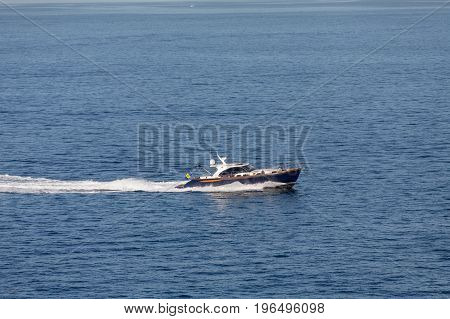 Blue and White Boat with flag of Barbados