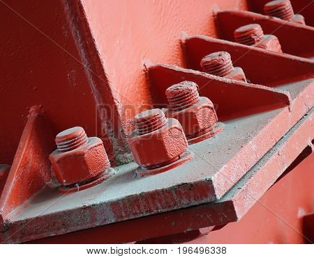 Heavy duty bolts and nuts hold a girder in place
