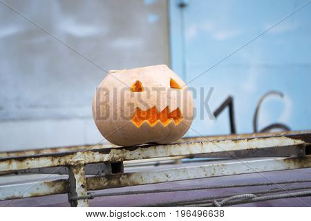 Preparing for Halloween. Pumpkin on a fence. Holiday