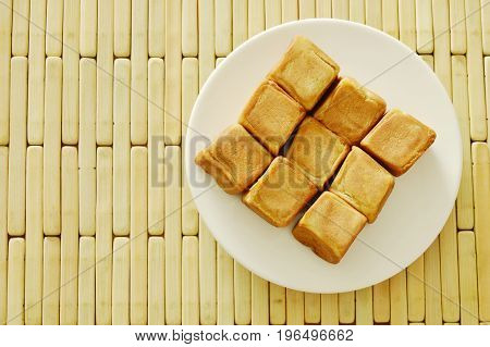 Chinese dice pasty stuffed mush sweet bean on plate