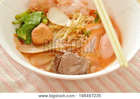 egg noodles with shrimp and fish ball in red soup Chinese-language called Yong Tau Fu