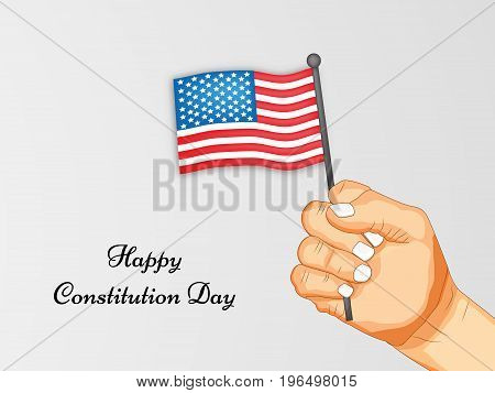 illustration of hand holding USA flag with Happy Constitution Day text on the occasion of USA Constitution Day