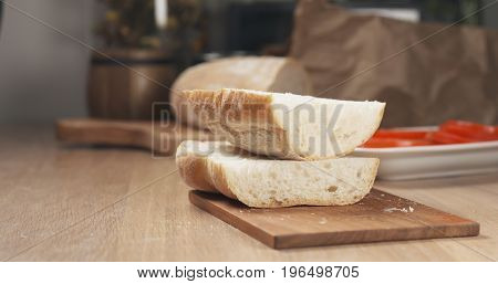 sliced in half ciabatta on cutting board, wide photo
