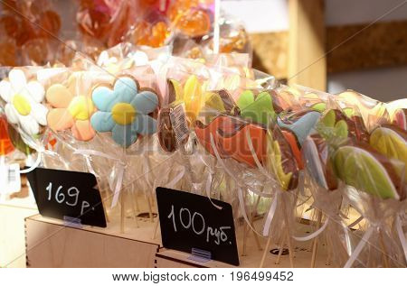 candy on a stick, selling gingerbread, colorful sweets