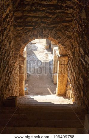 Dark Entrance To House Ruins With Stone Arc And Columns In Ephesus Archaeological Site In Turkey