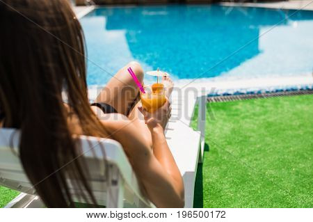 Woman Relaxing On Chaise Longue With Cocktail. Summer Time