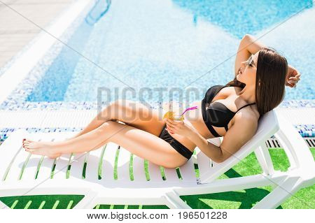 Happy Young Woman With Cocktail Laying On Chaise Longue. Summer Time