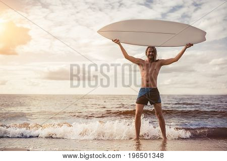 Young Man With Surfboard